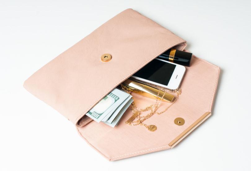 woman's open hand clutch, save money